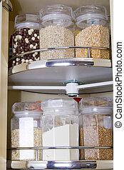 Grain in glass food storage jar in the cupboard