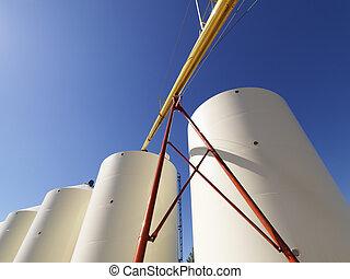 Grain silo storage. - Low angle view of metal grain storage...