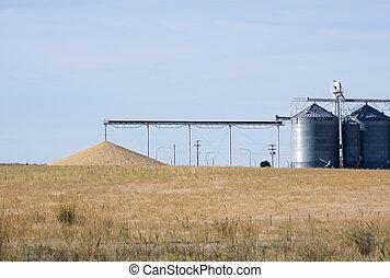 Grain silos with pile of grain