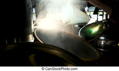 Grain sprinkle into steaming brewery kettle. Sprinkle the...
