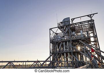 Grain bins - industrial background  A row of metal round grain