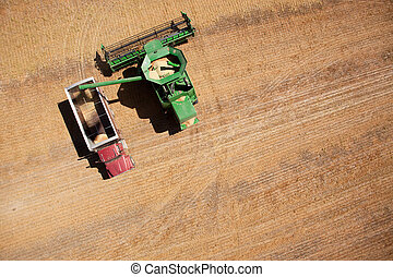 Grain Truck and Harvester - A harvester or combine filling a...