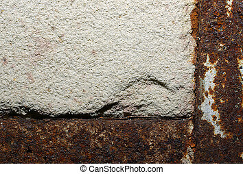 Grained concrete wall with rusty metal. Abstract textured background or backdrop.