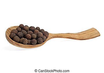 Grains of allspice on wooden spoon isolated on white background