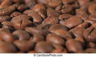 Grains of coffee on a table torque and release smoke....