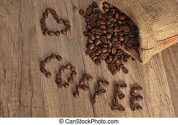 Grains of coffee on a wooden surface