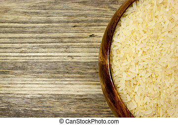Grains of rice in wooden plate
