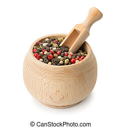 grains pepper and wooden scoop in pot