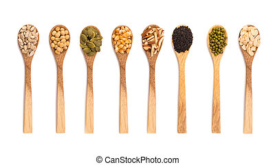 grains seeds in wooden spoon isolated on white background