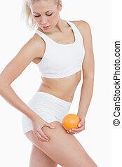 graisse, vérification, elle, dehors, orange, cuisse, femme, tient