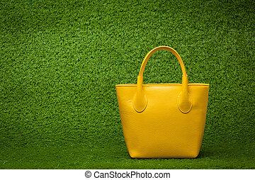 grama verde, bolsa