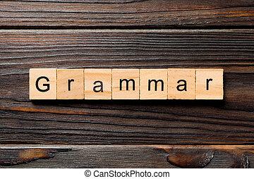 grammar word written on wood block. grammar text on table, concept.