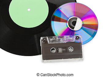 Gramophone disk, cd and cassette isolated on white ...