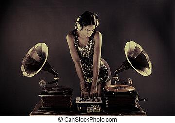 gramophone dj - sexy young woman djs using two retro antique...