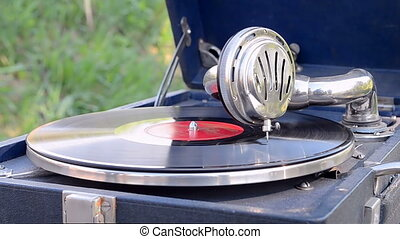 gramophone, vintage record player,rotating disc, stylus closeup,