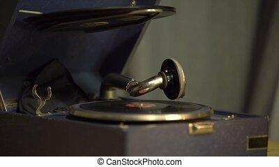 Gramophone with a vinyl record in a retro interior, a...