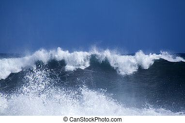 Gran Canaria, foamy waves breaking by the shore in Banaderos...