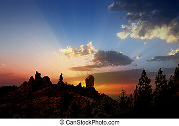 Gran canaria roque nublo fraile dramatic sunset sky in...