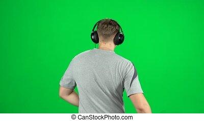 grand, écouteurs, dos, homme, musique, écran, écoute, vert, vue, va, danse, studio.