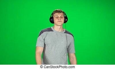 grand, écouteurs, homme, musique, écran, écoute, vert, va, danse, studio.