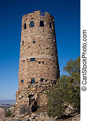 The Desert View Watchtower, constructed in 1932 as a replica of a prehistoric Indian tower, commands a magnificent view of the Grand Canyon, the Painted Desert to the east and the San Fransisco Peaks to the south.