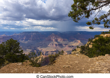 Grand Canyon view with stormy dark sky