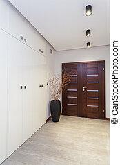 Grand design - door and corridor in white interior