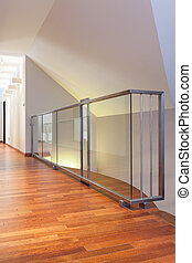 Grand design - closeup of glass banister at second floor