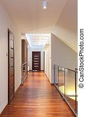 Grand design - long corridor in contemporary interior
