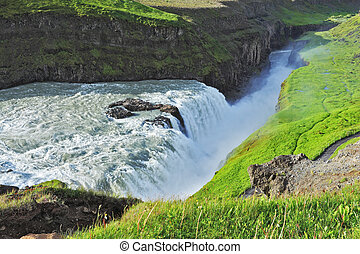 Grand Gullfoss. Iceland. In mid-July, bubbling water...