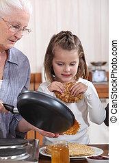 grand-mère, crêpes, petite-fille, confection