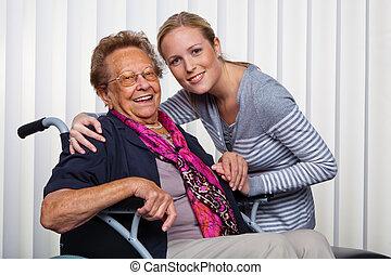 grand-mère, visited, fauteuil roulant, petits-enfants