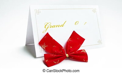 Grand opening text on greeteng card with bow