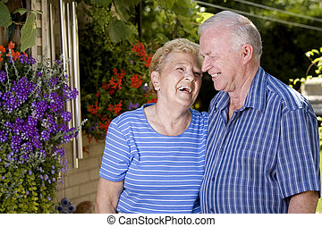 grand parents - happy grand parents in the summer looking at...