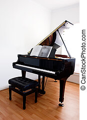 Grand Piano and stool on floorboards