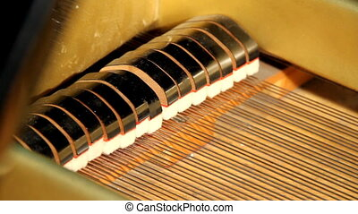Grand piano - Strings and hammer inside a piano