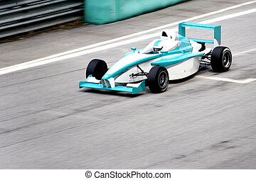 Grand prix racing car at starting grid.