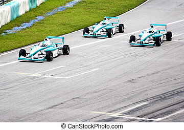 Grand prix racing cars in action.