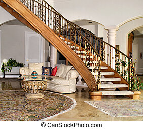 grand stairway leading to main living room in a beautiful home