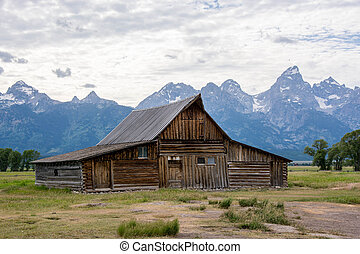 grand tetons with mormon farm in summer