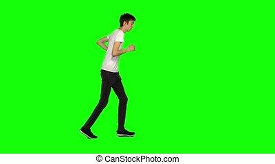 grand, vue., clã©, prise vue., maigre, profil, chroma, adolescent, vert, écran, arrière-plan., courant, type, 4k