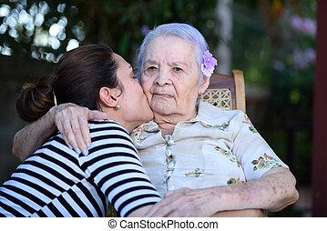 Grandaughter kissing grandma - Grandaughter happy kissing...
