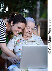 Grandaughter with grandma - Grandaughter teaching to grandma...