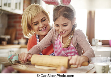 Grandchild helping with rolling pastry