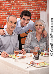 Grandchild with grandparents in restaurant