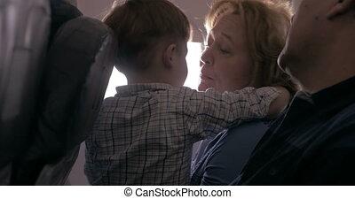 Grandchild with his grandparents in the plane