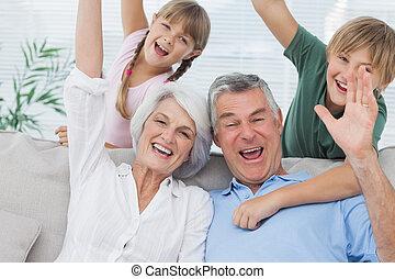 Grandchildren and grandparents raising their arms