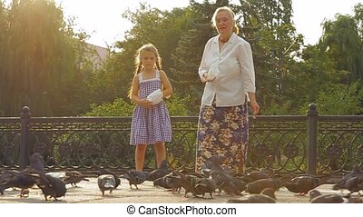 Granddaughter and grandmother in a park.