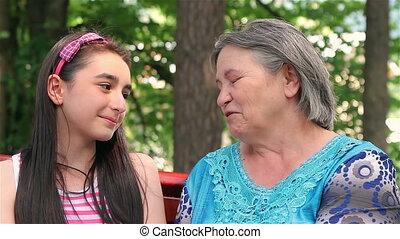 Granddaughter and grandmother talk