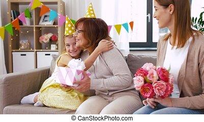 granddaughter greeting grandmother on birthday - family,...